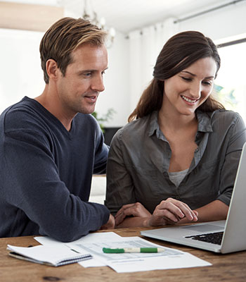 Couple looking at finances on laptop computer